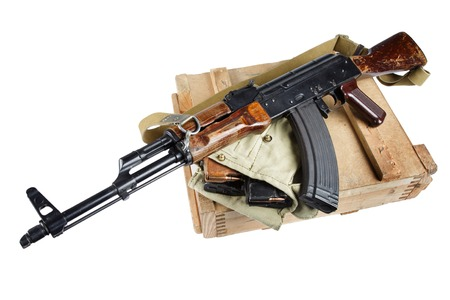 wooden box of ammunition with AK rifle and ammunition isolated