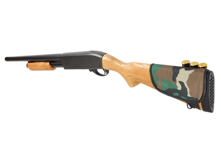 pump action shotgun with butt stock ammo holder isolated on white