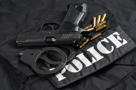 Police uniform with handgun and ammunition background