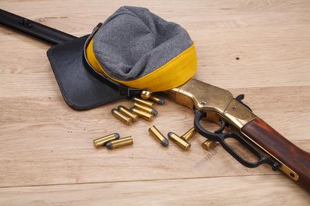 Civil War period rifle on wooden table Фото со стока