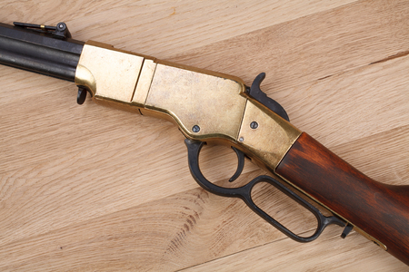 Wild west period rifle on wooden table