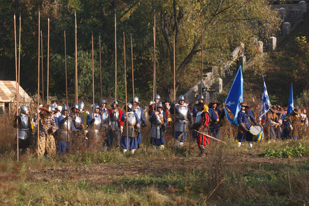 KAMYANETS-PODILSKY, UKRAINE - OCTOBER 3, 2009: Members of history club wear historical uniform 17 century during historical reenactment festival. The west European pikemen and musketeers