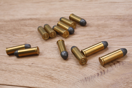Wild west period ammunition on wooden table