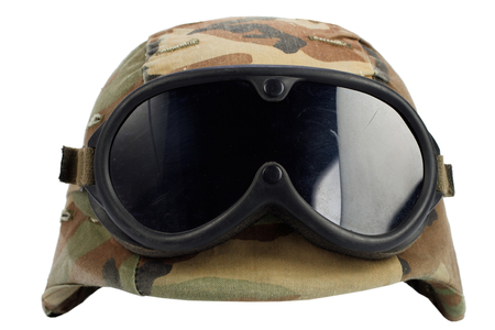 us army helmet with goggles isolated on white