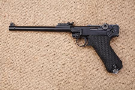World War I period german army handgun on canvas background Reklamní fotografie