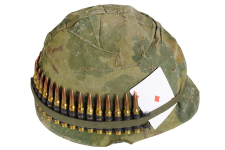 US Army helmet Vietnam war period with camouflage cover and ammo belt, dog tag and amulet - playing card ace of diamonds