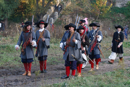 KAMYANETS-PODILSKY, UKRAINE - OCTOBER 3, 2009: Members of history club wear historical uniform 17 century during historical reenactment festival. The west European musketeers