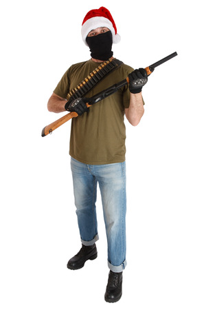 robber in black mask and cap of Santa Claus with shotgun isolated Stock fotó