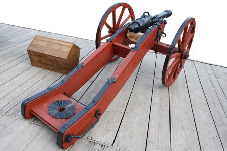 old vintage gunpowder cannon on wooden deck