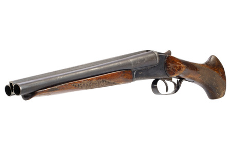 Illegal weapon - sawn off shotgun isolated on white background Фото со стока