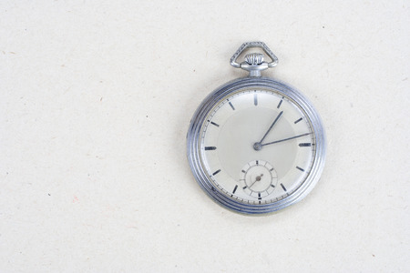 retro pocket watch on white textured background