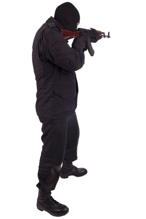 man in black uniform and mask with AK 47 gun isolated on white background