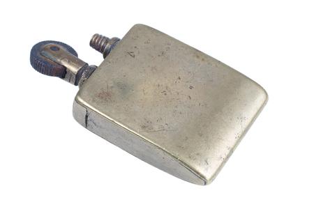 Vintage handmade cigarette lighter isolated on a white background