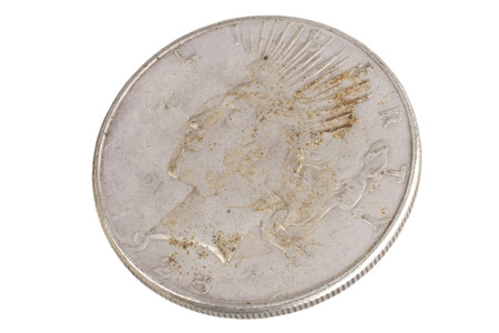 old vintage silver dollar isolated on background 免版税图像