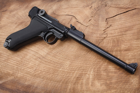 World War I period german army handgun on wooden table