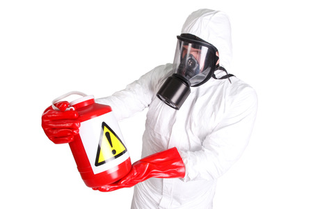 Man in hazardous materials suit isolated on white