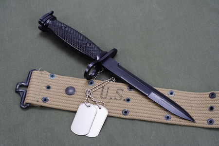 bayonet on US ARMY uniform background Stock Photo