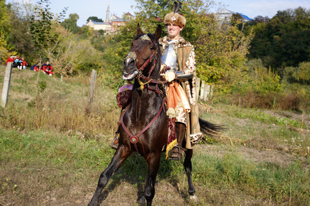 KAMYANETS-PODILSKY, UKRAINE - OCTOBER 3, 2009: Members of history club wear historical uniform 17 century during historical reenactment festval. The Polish Winged Hussars Sajtókép