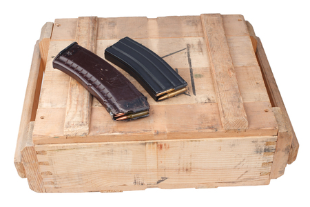m16 and ak47 magazins on wooden box isolated Banque d'images