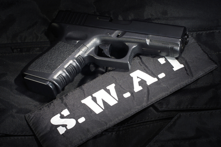 SWAT weapon and equipment on black uniform background