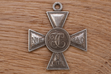 Imperial Russia award - Imperial Cross of Saint George IV class on wooden table