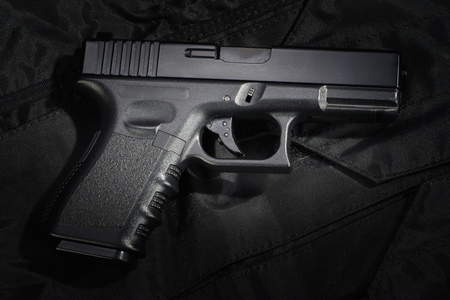 Police weapon and equipment on black uniform background