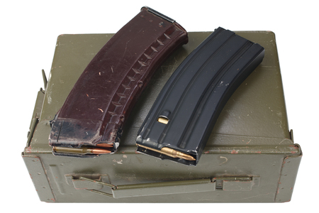 m16 and ak47 magazins on ammunition can isolated