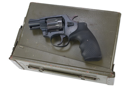 Revolver on the ammunition box isolated Stock Photo