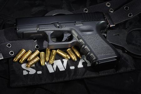 SWAT weapon and equipment on black uniform background Stok Fotoğraf - 105695283