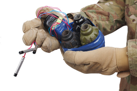defused improvised explosive device (IED) in hand isolated 免版税图像