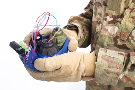 defused improvised explosive device (IED) in hand isolated Фото со стока