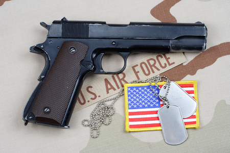 Colt government 1911 with U.S. AIR FORCE uniform background