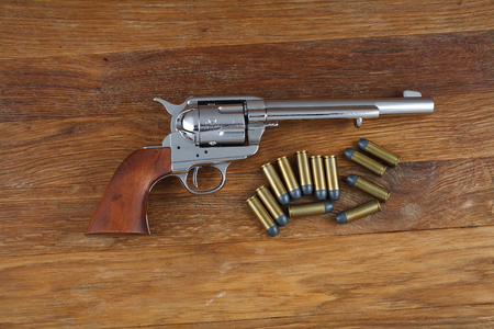 wild west revolver - colt single action army on wooden background