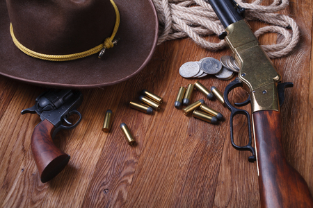 Wild west weapon and ammunition on wooden table Stock Photo