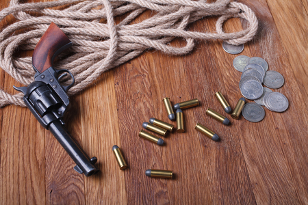 Wild west rifle, ammunition on wooden table Stock Photo