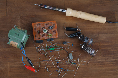 soldering iron - do it yourself concept with vintage retro electronic components Standard-Bild