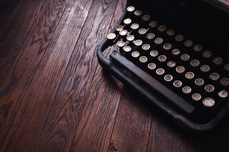 Old retro vintage typewriter on wooden table