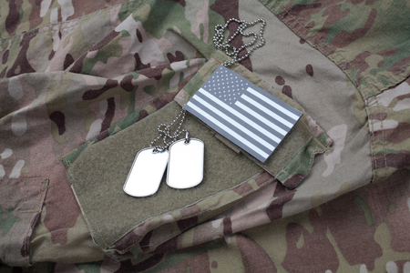 US flag patch with dog tag on US ARMY multicam camouflage uniform