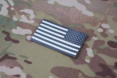 US ARMY flag patch on US ARMY camouflage uniform