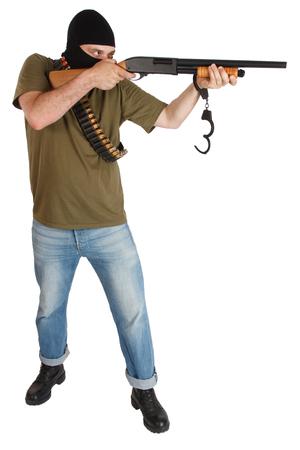 prison break - robber in black mask with shotgun removing handcuffs