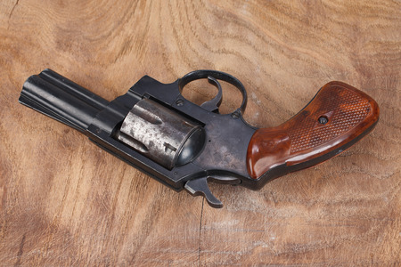 Revolver with ammunition on the wooden background Reklamní fotografie