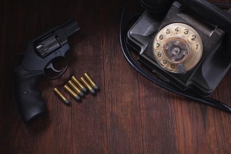 handgun, cartridges and phone on wooden table Reklamní fotografie