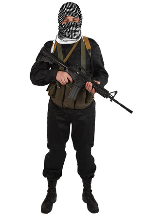 insurgent dressed in black uniform and black and white shemagh with m4 assault rifle isolated on white