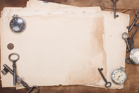 old papers and pen with vintage pocket watch background