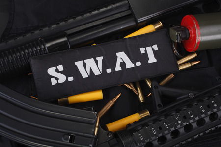 Special weapons and tactics team equipment on black uniform background