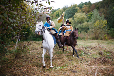 KAMYANETS-PODILSKY, UKRAINE - SEPTEMBER 29, 2018: Members of history club wear historical uniform 17 century during historical reenactment. The Polish Cavalry in action.