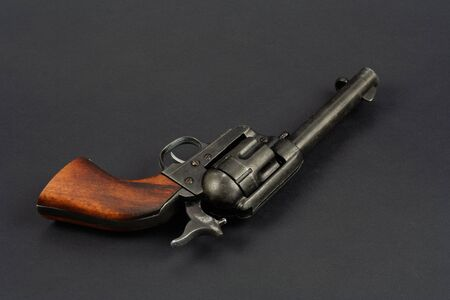 wild west revolver - single action army on black background