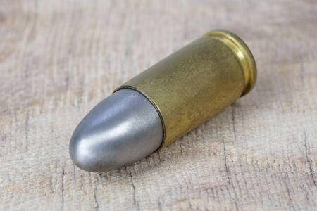 9x19mm Parabellum a firearms cartridge that was designed by Georg Luger and introduced in 1902 for the German weapons on wooden background Stock fotó