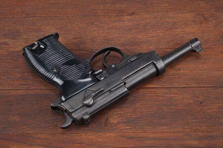 WWII era german army handgun on wooden table