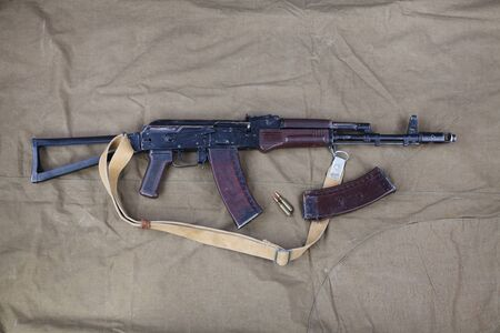 AK 74 with ammunitions on canvas background